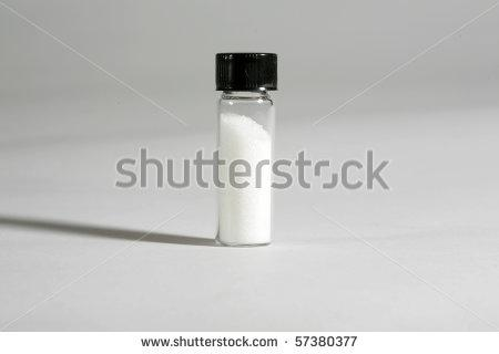 Stock photo a small glass vial contains an unknown white substance